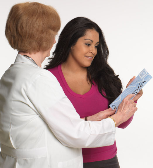 Doctor showing a patient a brochure
