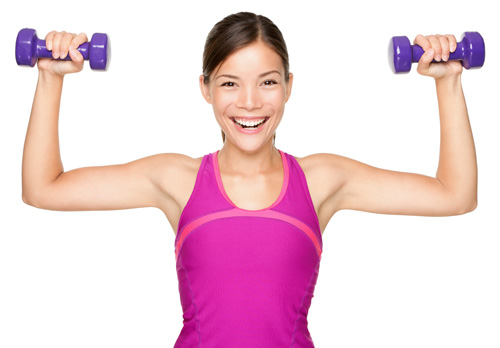 Woman holding two dumbbells.