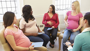 Group of pregnant women sitting and talking