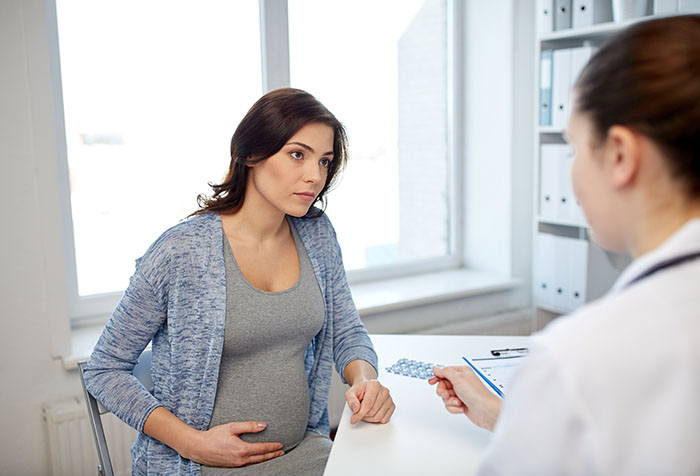 Doctor and pregnant woman discussing medications