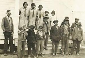Sadie (top row, far left) attending the #19 Day School in Pine Ridge, South Dakota in 1923