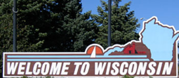 Photo of road sign with text welcome to Wisconsin