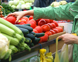 Photo: woman reaching for healthy fruits and vegetables
