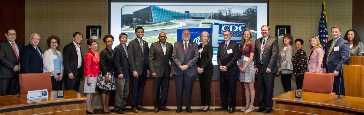 New state and local health officials pose with CDC Director Dr. Robert R. Redfield (center) and CSTLTS Director Dr. José Montero (far left) at the New Health Official Orientation held in May 2018.