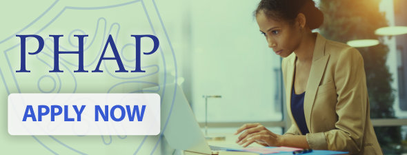 A young woman working at a laptop computer, a nearby interpretation of the PHAP Shield logo, the title PHAP, and a button with Apply Now on it