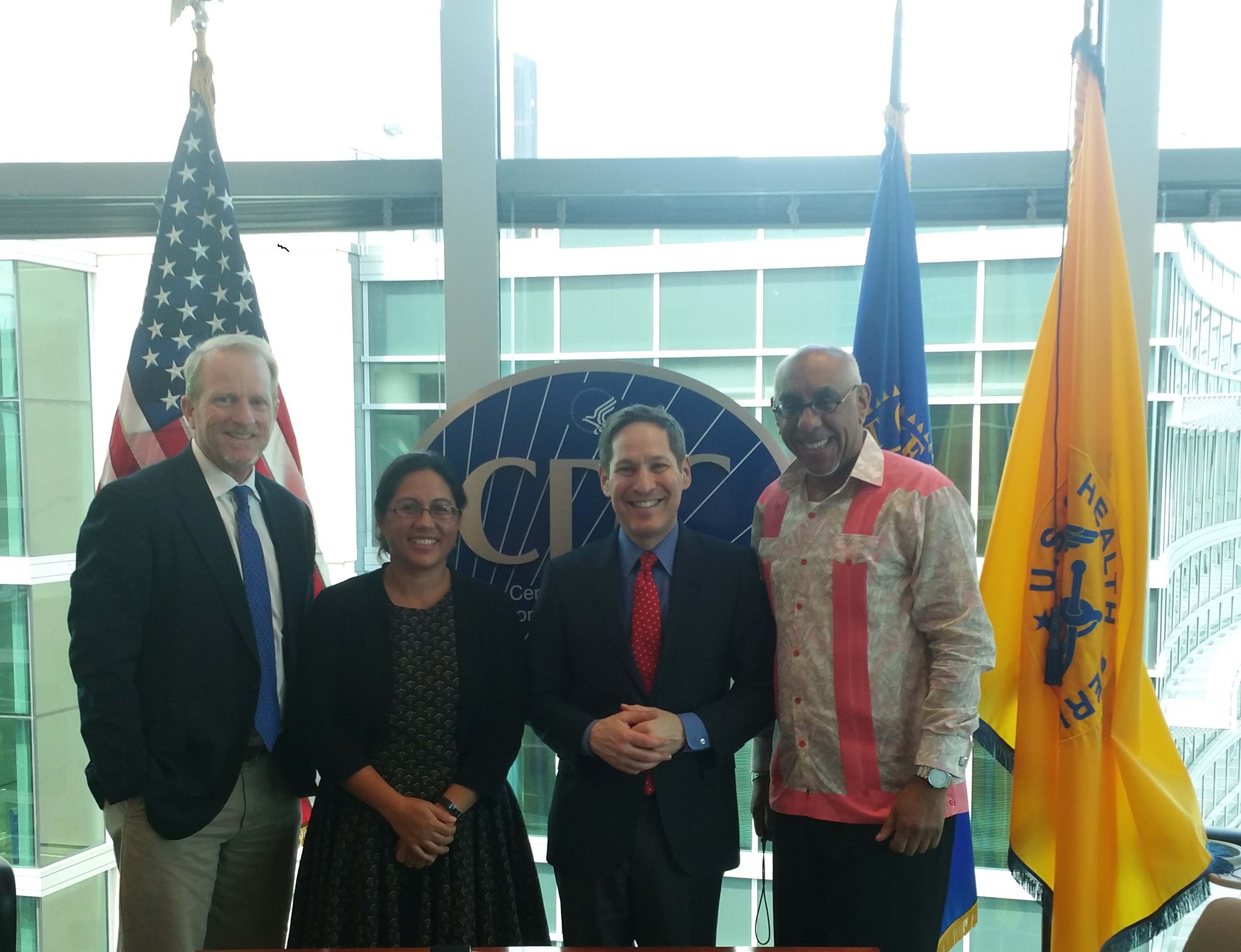 PIHOA Executive Director Emi Chutaro (2nd from left} and members of the OSTLTS Partnership Support Unit visit with CDC Director Dr. Tom Frieden (2nd from right) at CDC Headquarters