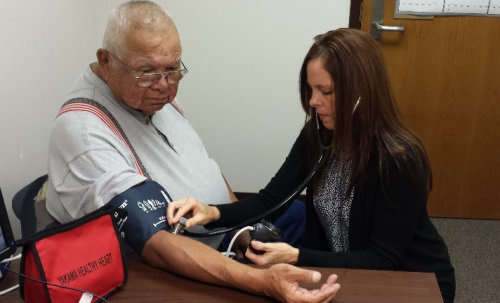 Clinician Checking a Patients Blood Pressure