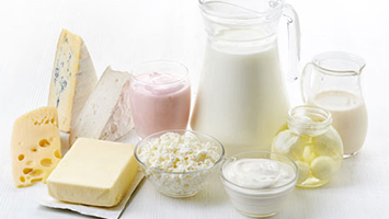 Various dairy products including milk, cheeses, and butter