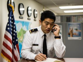 photo of a man in uniform making a phone call at an airport