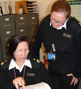 Two public health officers looking over a document.