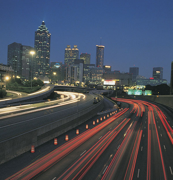 Atlanta's skyline and busy highway at night.