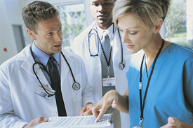 three doctors reviewing medical charts
