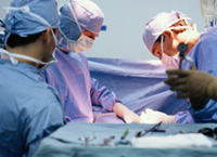 Group of doctors performing surgery