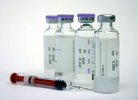 syringe and vials of medicine
