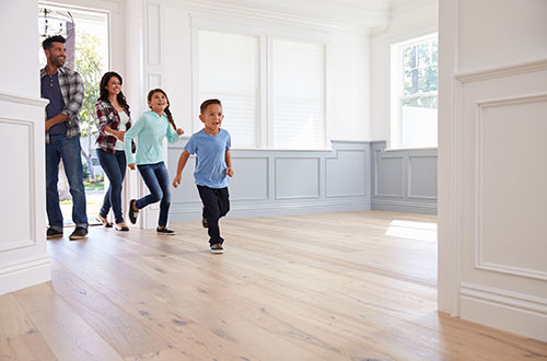 a family entering an unfurnished home