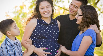 image of a pregnant woman and her family