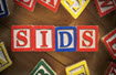 image of children's blocks spelling the acronym SIDS