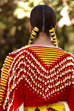 The back of a native american woman in costume