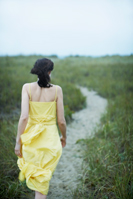 image of a woman walking away on a path