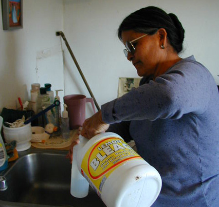 woman mixing bleach and water
