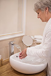 Senior woman washing her hands
