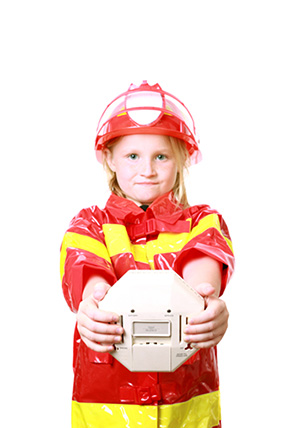 photo: girl holding smoke detector
