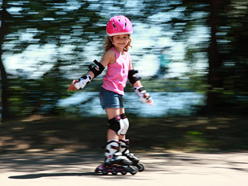 Child Safety : girl skater wearing protective gear