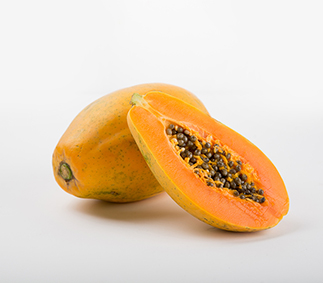 Photo of a papaya cut open