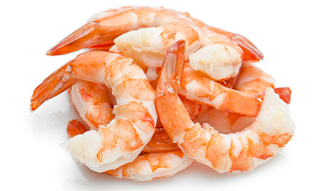 Cooked shrimp over a white background
