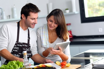 Couple cooking together in the kitchen.