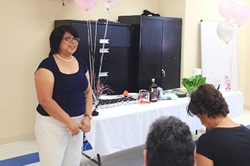 Photo of Ms. Maria Barrera making a presentation.