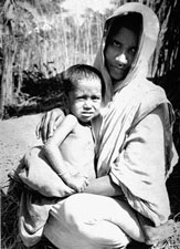 Three-year-old Rahima Banu, who is the last known person to have had naturally acquired smallpox, or variola major, in the world, with her mother in Bangladesh. Her case was reported to the local Smallpox Eradication Program team by an 8-year-old girl named Bilkisunnessa, who was paid 250 Taka reward for her diligence. Source: CDC/ World Health Organization; Stanley O. Foster M.D., M.P.H.