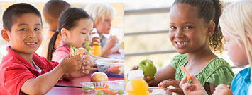 Niños comiendo un almuerzo saludable en una escuela primaria