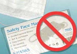 Foto de un paquete de mascarillas de seguridad. La caja está marcada con N95. El símbolo rojo de no (circulo con línea en diagonal que lo cruza) está superpuesto a la imagen.