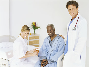 Photo: Doctor and nurse with older adult male patient