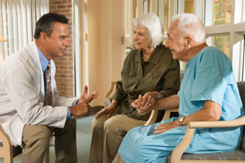 Photo: Doctor speaking to an older couple