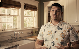 Hawaiian male standing in kitchen talking to camera