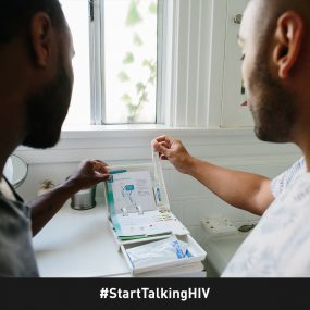 Image displays two men opening an at-home HIV test kit.