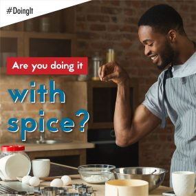 Image displays a man applying a pinch of salt to the ingredients of the meal he is preparing, along with the following text: Are you doing it with spice?