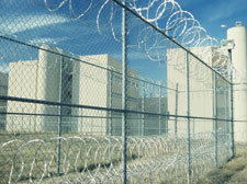 prison with barbed wire fence