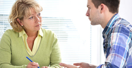 a parent talking to a social worker
