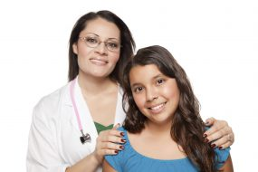 portrait of a female healthcare provider and young female teen