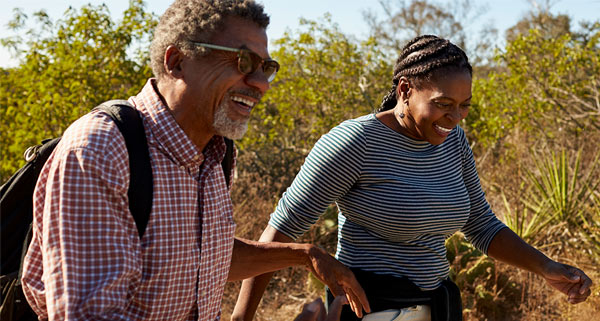 African american couple walking outdoors