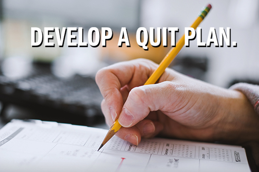 Develop a Quit Plan - picture of a hand writing in a calendar.