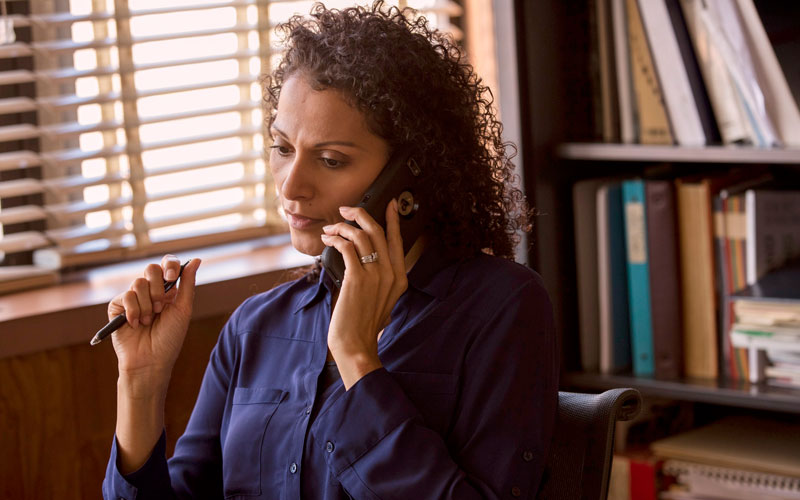 You can get helpful Quitline tips - woman on talking on the phone