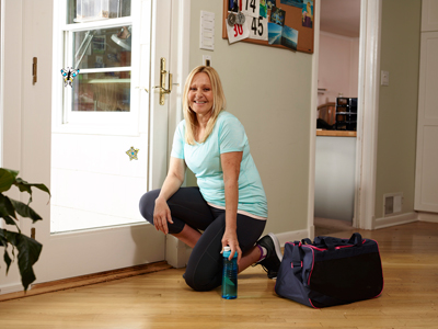 Rebecca, kneeling down by door, ready to go out for a run.