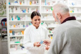 pharmacist assisting customer