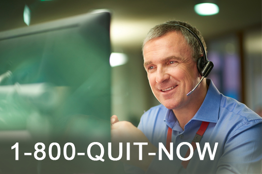 1-800-QUIT-NOW - picture of a man with headset in front of a computer monitor