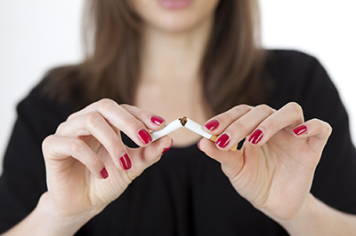 Image of a person breaking a cigarette