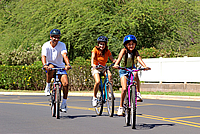 Family biking on a street